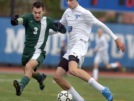 Geneseo's Kyle Rollins, right, takes a shot on goal