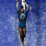 American gymnast Simone Biles on the balance beam.