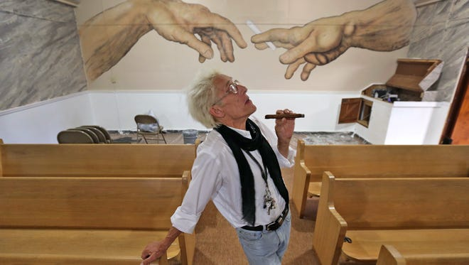 Bill Levin poses in the sanctuary at The First Church of Cannabis in Indianapolis on June 23, 2015. This photograph by IndyStar photographer Kelly Wilkinson won third place in Portrait Personality category at the 2014 Indiana News Photographer Association competition.
