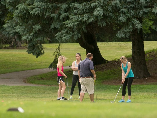 Golfers enjoy a round of golf at Hilltop Golf Course in Plymouth Township.