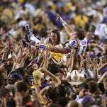 LSU Tigers wide receiver Trey Quinn (8) crowd surfs after fans stormed the field following the Tigers' 10-7 victory agains Ole Miss on Oct. 25, 2014 at Tiger Stadium in Baton Rouge.