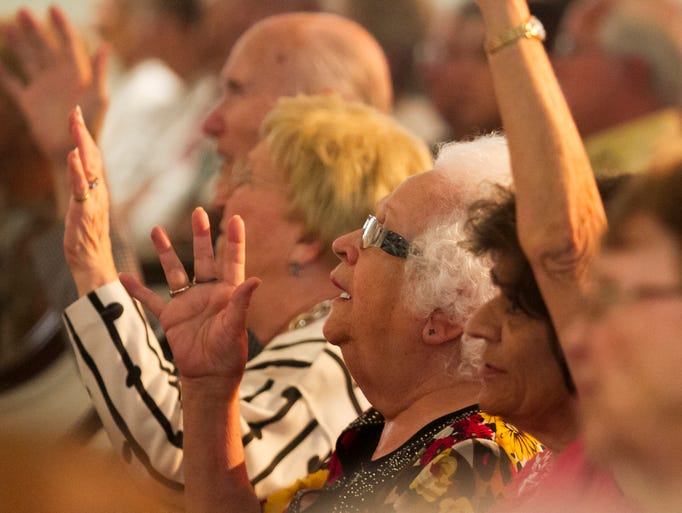 "Horace Smith, left, his wife Constance, Norma Evans, center, and Louise Dupre, right, sing ""He Lives"" at the 17th annual ""A Midsummer Night's Sing,"" at First Presbyterian Church of Fort Myers. The event was sponsored by the Galloway Family of Dealerships. Cash donations and cans of non-perishable food were collected to benefit Community Cooperative (The Soup Kitchen)."