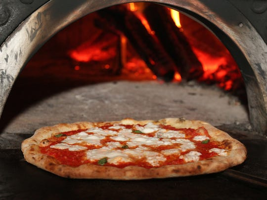Pizza fresh out of the wood-fired oven at Porta in Asbury Park.