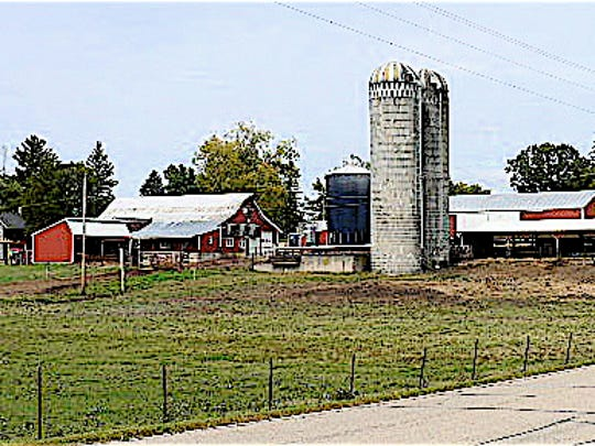Red barn, silos, farm house green grass - what we grew up with.