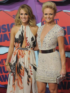 Carrie Underwood and Miranda Lambert on the CMT Red Carpet at the Bridgestone Arena in Nashville, Tenn.,  on Wednesday, June 4, 2014.