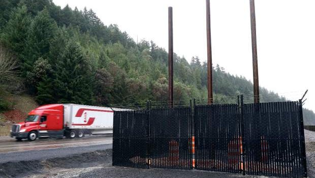 A truck passes near the site of a future Oregon Department of Transportation data site on Interstate 5 near Canyon Mountain on Saturday.