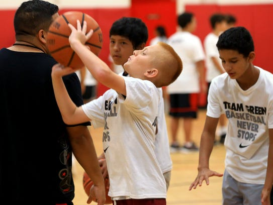 Athletes work on basketball skills during the Danny