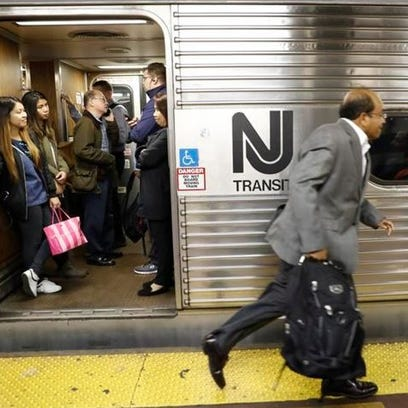 An afternoon rush hour commuter rushes to board a crowded