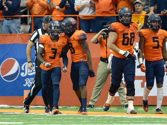 Syracuse wide receiver Ervin Phillips (3) celebrates his touchdown with wide receiver Steve Ishmael (8) during the first half of an NCAA college football game against Clemson, Friday, Oct. 13, 2017, in Syracuse, N.Y. (AP Photo/Adrian Kraus)
