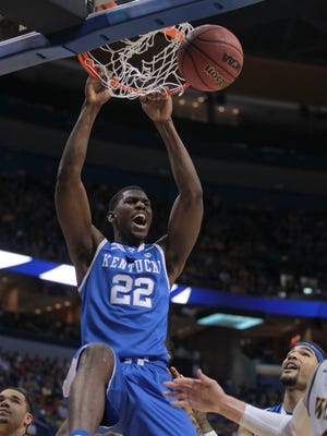 Kentucky's Alex Poythress dunks against Wichita State on Sunday at the Scottrade Center in St. Louis. The lead changed hands three times in the game's final three minutes. UK prevailed 78-76.