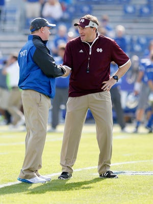 Oct 25, 2014; Lexington, KY, USA; Mississippi State Bulldogs head coach Dan Mullen talks with Kentucky Wildcats head coach Mark Stoops before the game at Commonwealth Stadium.