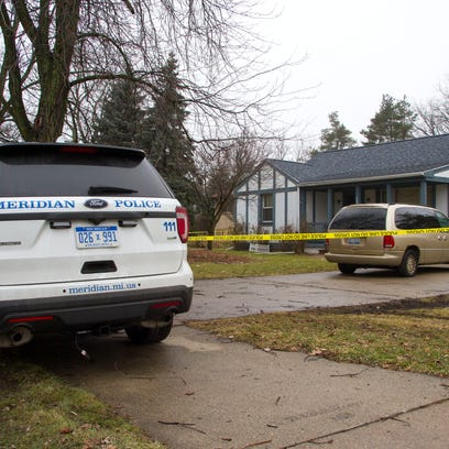 Meridian Township police investigate a double homicide
