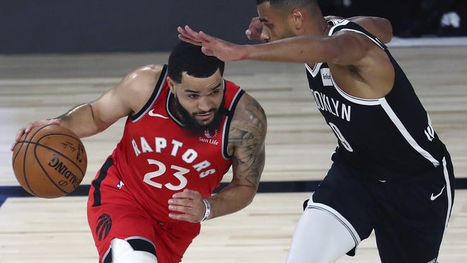 "Toronto Fred VanVleet, left, said it's difficult to get excited about basketball when it appears the social justice drives by NBA players aren't effective. ""It's starting to feel like everything we're doing is just going through the motions and nothing's really changing,"" he said."
