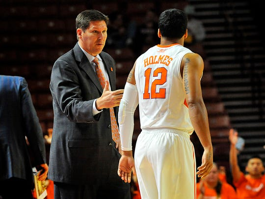 Clemson head basketball coach Brad Brownell talks with guard Avry Holmes (12) during a timeout against North Carolina Central at the Bon Secours Wellness Arena in Greenville on Nov. 13, 2015.