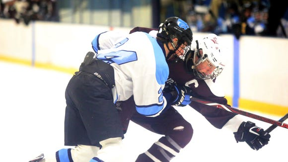 Suffern's Harrison Dganski (24) and Scarsdale's Jack Brosgol (14) battle for control of the puck during Section 1 Division I quarterfinals at Sport-O-Rama in Monsey Feb. 19, 2018. Suffern defeats Scarsdale 5-1.
