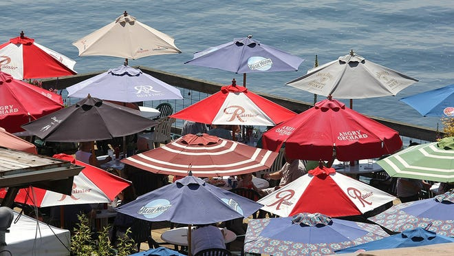 Outdoor seating umbrellas at the Boat Shed Restaurant in Manette on Friday, May 13, 2016.