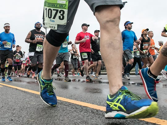 A sea of runners leave the starting line at the Murfreesboro Half Marathon in 2015.