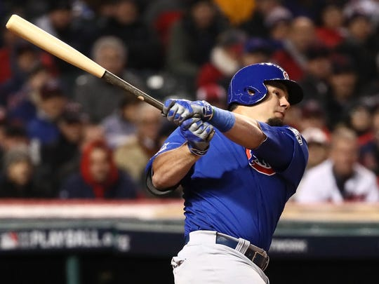 Kyle Schwarber hits an RBI single to score Anthony Rizzo during the third inning against the Cleveland Indians in Game 2 of the 2016 World Series.