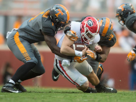Tennessee defensive lineman Kendal Vickers (39) and Tennessee defensive lineman Jonathan Kongbo (1) tackle Georgia quarterback Jake Fromm (11) during the Tennessee Volunteers vs. Georgia Bulldogs game at Neyland Stadium in Knoxville, Tennessee on Saturday, September 30, 2017.
