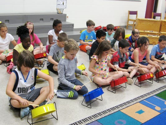 636625822592657945-The-steel-drums-were-a-new-experience-for-most-students-and-they-were-eager-to-start-playing.JPG