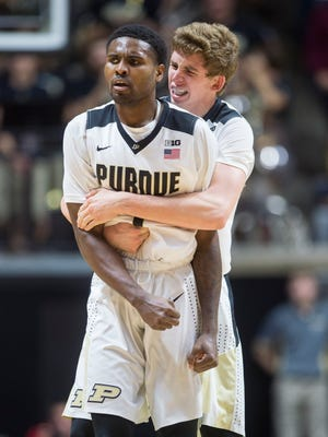 Purdue guard Johnny Hill (1), right, celebrates with teammate guard Ryan Cline (14) after forcing a turnover against New Mexico during the second half of an NCAA college basketball game, Saturday, Dec. 5, 2015, in West Lafayette, Ind. Purdue won 70-58. (AP Photo/Doug McSchooler)