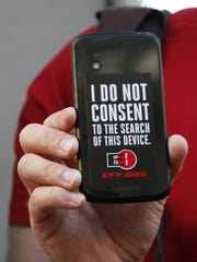 A protester rallies in support of data privacy outside