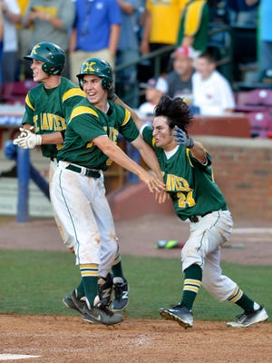 St. Xavier's Chris Esselman, left, and Zeke Porta celebrate following Esselman scoring the winning run in their 3-2 victory over McCracken County in their Kentucky State baseball semifinal game, Friday, June 17, 2016 in Lexington Ky. (Timothy D. Easley/Special to the C-J)