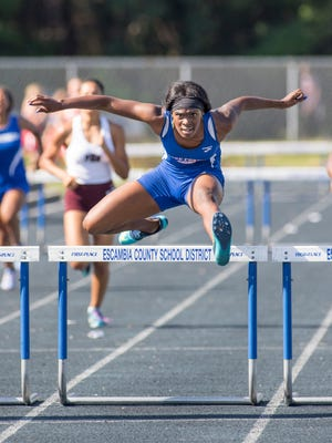 Pine Forest High School's Michaela Thompson wins the girls 300 meter hurdles finals with a time of 44.92 during the FHSAA 3A District 1 track meet at Booker T Washington High School in Pensacola on Wednesday, April 19, 2017.