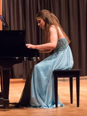 Alyssa Weissman, a graduate student at Carroll University, competes in the talent segment of the Miss New Berlin pageant at Carroll University in Waukesha in 2015. This year's Miss New Berlin and Miss West Allis pageant will take place Feb. 3 at Nathan Hale High School in West Allis.