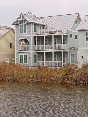 236 Bent Grass, in  Port Aransas' incredible Cinnamon Shore development, is walking distance to the beach, swimming pool and overlooks a lake.