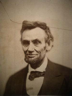 """The original print of the """"cracked-plate"""" portrait of Abraham Lincoln is on display at the National Portrait Gallery on Thursday, Feb. 12, 2015, in Washington, D.C. Lincoln said, """"My policy is to have no policy."""" (Olivier Douliery/Abaca Press/TNS)"""