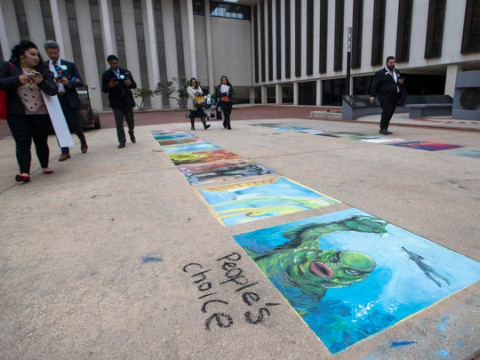 The Chalk Walk event at the state Capitol, an initiative by Council on Culture & ArtsandLeon County Schools, helped students create sidewalk designs on the Historic Capitol grounds for visitors on Wednesday, Jan. 24, 2018.