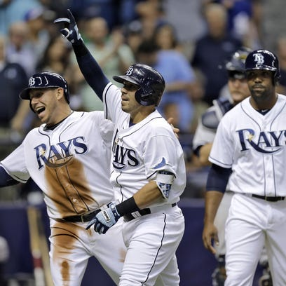 The Rays' Rene Rivera (center) celebrates his three-run home run off New York Yankees relief pitcher Esmil Rogers last May. On Saturday, Rivera caught all nine innings in his Mets debut.