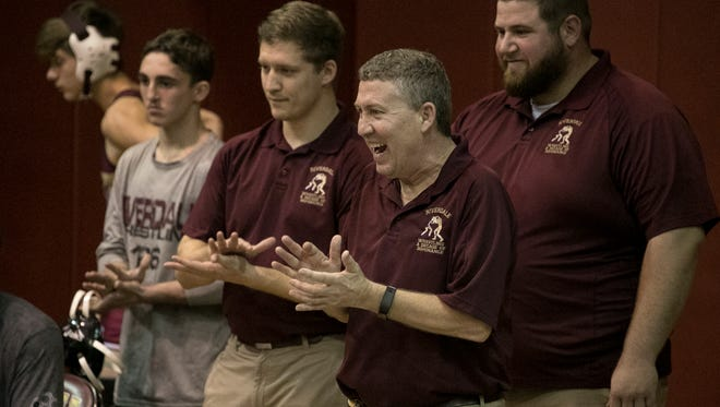 Riverdale coach Kris Hayward has won two team wrestling titles and guides the Raiders into the Class 2A state duals quarterfinals Friday at Kissimmee Osceola High on Friday.