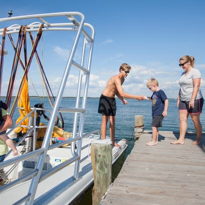 Jake Wilson of Key Sailing helps Layton Henderson,
