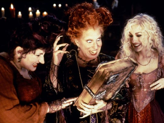 "Kathy Najimy (left), Bette Midler and Sarah Jessica Parker star as 17th Century witches who accidentally find themselves in modern day Salem, Massachusetts in ""Hocus Pocus."""