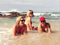 Lauren Conrad (C) palled around in the water with a few friends while on vacation.