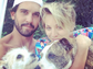 Kaley Cuoco and husband Ryan Sweeting cozied up to their dogs in this summery family photo.