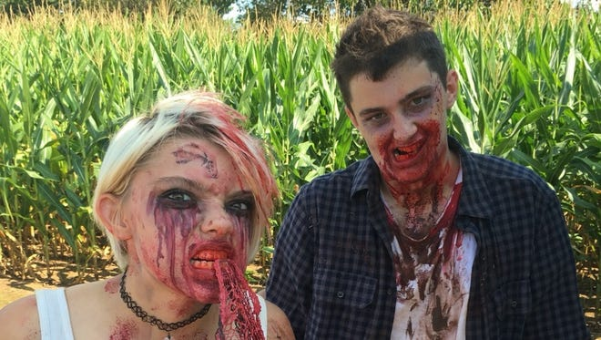 Zombies at zombie laser tag are made up in professional makeup.