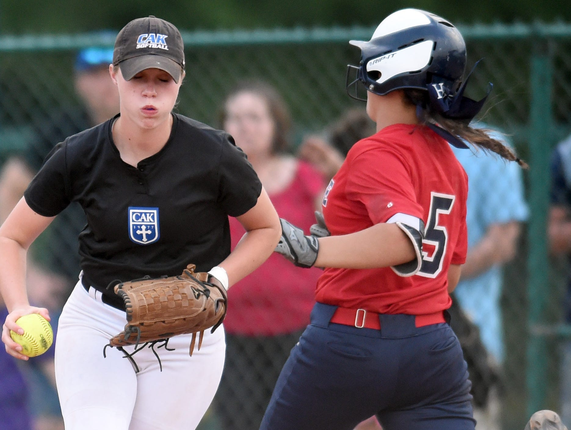 CAK's Caroline Cavin (44), left, gets White House Heritage's Alyssa Arden (5) out at first base in a Class AA state championship softball game at StarPlex Park in Murfreesboro during Spring Fling on Friday, May 27, 2016. CAK won 4-0.
