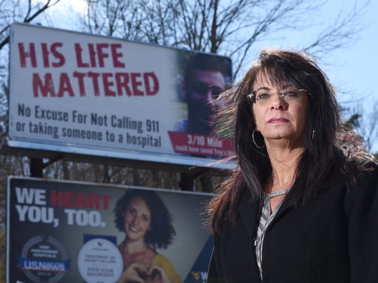 Lenora Lada stands in front of a billboard erected