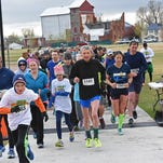 READY, SET, GO!  Runners and walkers start the 5K race Saturday at Boardwalk Park in Windsor as part of the Arbor Day festivities.