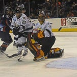Eagles goalie Jacob Deserres blocks a shot against the the Ontario Reign during 1st quarter playoff action Sunday night at the Budweiser Events Center.