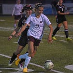 Windsor freshman forward Chaynee Kingsbury advances the ball against Holy Family Monday night as the Wizards won 2-1.