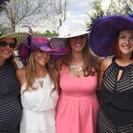 From left to right, Sarah from Australia, Sharis Ainslie, Rachel Jensen, & Robben George from Ft. Collins, show off their hats at the Down & Derby NoCo Unify party on the island at Water Valley.