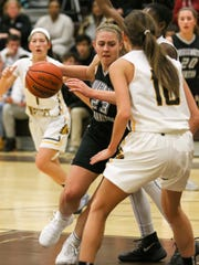 Bridgewater-Raritan's Teresa Wolak is blocked by Watchung Hills' defense during the first half on Friday, Dec. 15, 2017.