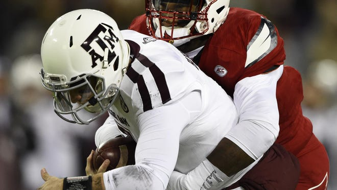 Texas A&M quarterback Jake Hubenak (7) is sacked by Louisville linebacker Devonte Fields (92) in the first half at the Franklin American Mortgage Music City Bowl at Nissan Stadium.