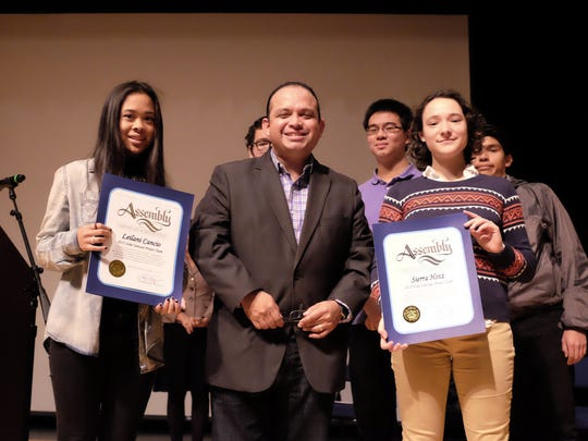 California State Assemblymember Luis Alejo presents a certificate of recognition to seniors Leilani Cancio, left, and Sierra Hotz, who will traveling to Kenya as part of Salinas High SchoolÕs Solar Suitcase Team.