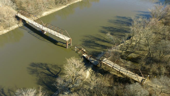 The west-side portion of the Wagon Wheel Bridge in Boone County has collapsed into the Des Moines River after suffering damage in late February because of flowing ice. Officials with the Iowa Department of Natural Resources are urging kayakers and canoeists to avoid the area just southwest of Boone until it is cleaned up.