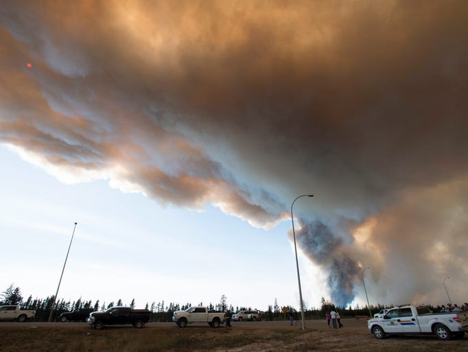 Smoke rises from a wildfire about 18 miles south of